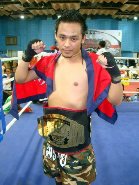 Raul after winning the WPKA World Kick Boxing Championship belt